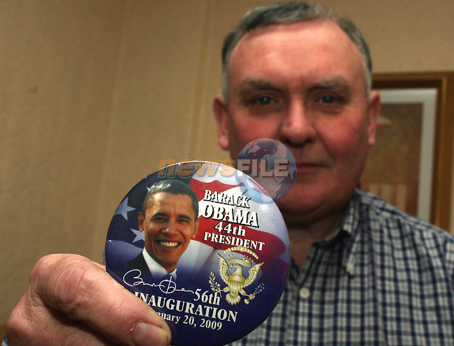 Thomas J. Reilly holding a Barack Obama badge given to him by his son, Patrick Reilly, a journalist from Drogheda who did voluntary work for Barack Obama's campaign in Houston, Texas.  .Patrick recieved a silver ticket and is attending the inauguration in Washington today...Photo NEWSFILE/Jenny Matthews.(Photo credit should read Jenny Matthews/NEWSFILE)....This Picture has been sent you under the condtions enclosed by:.Newsfile Ltd..The Studio,.Millmount Abbey,.Drogheda,.Co Meath..Ireland..Tel: +353(0)41-9871240.Fax: +353(0)41-9871260.GSM: +353(0)86-2500958.email: pictures@newsfile.ie.www.newsfile.ie.FTP: 193.120.102.198.