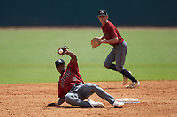 Shortstop Kahlil Watson (9) of Wake Forest HS in Wake Forest, NC playing for the Arizona Diamondbacks scout team can't handle a wide throw at second base during the East Coast Pro Showcase at the Hoover Met Complex on August 5, 2020 in Hoover, AL. (Brian Westerholt/Four Seam Images)