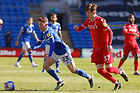 (L-R) Harry Wilson of Cardiff City challenged by James Garner of Nottingham Forest during the Sky Bet Championship match between Cardiff City and Nottingham Forest at the Cardiff City Stadium, Cardiff, Wales, UK. Friday 02 April 2021