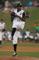 Kane County Cougars pitcher Robinson Yambati #40 delivers a pitch during a game against the Beloit Snappers at Fifth Third Bank Ballpark on June 26, 2012 in Geneva, Illinois. Beloit defeated Kane County 8-0. (Brace Hemmelgarn/Four Seam Images)