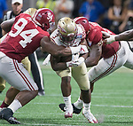 Alabama lineman Da'Ron Payne (94) and Da'Shawn Hand, right, close in on Florida State running back Derwin James in the first half of the Chick-fil-A Kickoff game at the new Mercedes-Benz Stadium in Atlanta, Georgia on September 2, 2017.   Photo by Mark Wallheiser/UPI