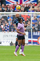 25th September 2021; Dens Park, Dundee, Scotland: Scottish Premiership football, Dundee versus Rangers; Liam Fontaine of Dundee heads clear from Alfredo Morelos of Rangers
