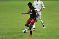 WASHINGTON, DC - SEPTEMBER 27: Chris Odoi-Atsem #3 of D.C. United passes off the ball during a game between New England Revolution and D.C. United at Audi Field on September 27, 2020 in Washington, DC.