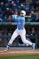 Jackson Hesterlee (26) of the North Carolina Tar Heels follows through on his swing against the Charlotte 49ers at BB&T BallPark on March 27, 2018 in Charlotte, North Carolina. The Tar Heels defeated the 49ers 14-2. (Brian Westerholt/Four Seam Images)