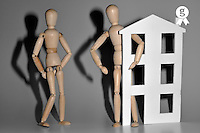 Wooden mannequin couple with a house shape (Licence this image exclusively with Getty: http://www.gettyimages.com/detail/97659150 )