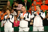 10-2-06, Netherlands, tennis, Amsterdam, Daviscup.Netherlands Russia, Dutch supporting team, left to right: teamdockter Babette Pluim, davis cup manager Koert Beek anf Fysiotherapist Jurgen Roordink