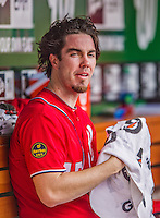22 September 2013: Washington Nationals pitcher Dan Haren sits in the dugout during a game against the Miami Marlins at Nationals Park in Washington, DC. The Marlins defeated the Nationals 4-2 in the first game of their day/night double-header. Mandatory Credit: Ed Wolfstein Photo *** RAW (NEF) Image File Available ***