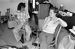 Moving house, couple exhausted tired out having a smoke. The removal men have left and they are surrounded by their furniture, 1977 their new home on new housing estate Milton Keynes Buckinghamshire 1970s UK