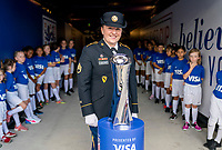 ORLANDO, FL - MARCH 05: A member of the military stands with the SheBelieves trophy during a game between Spain and Japan at Exploria Stadium on March 05, 2020 in Orlando, Florida.