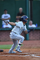 Jelfry Marte (5) of the Princeton Rays follows through on a swing against the Elizabethton Twins at Northeast Community Credit Union Ballpark on July 23, 2019 in Elizabethton, Tennessee. The Rays defeated the Twins 8-3. (Tracy Proffitt/Four Seam Images)