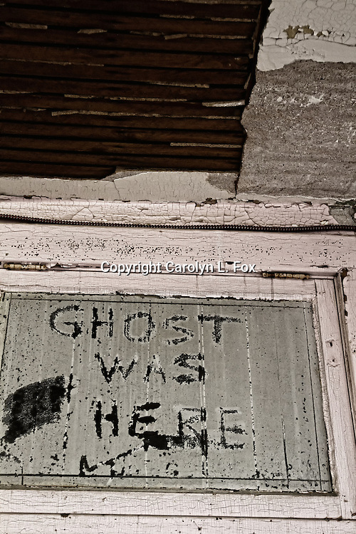 Someone wrote Ghost was here on an old door in an old building near Kansas City, Missouri.