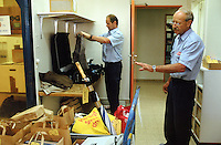 Switzerland. Bern. Regionalfgefängnis. Jail. Detention awaiting trial (commital for trial or pending trial). Loss of liberty. The prison warders Mr. Röthlisberger and Lehmann at work in the room where are strored the personal belongings of the prisoners.  © 2005 Didier Ruef