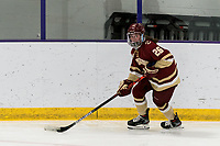 WORCESTER, MA - JANUARY 16: Sidney Fess #26 of Boston College brings the puck forward during a game between Boston College and Holy Cross at Hart Center Rink on January 16, 2021 in Worcester, Massachusetts.