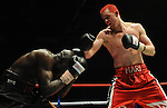 Hari Miles ( Red with Black stripe ) V Nick Okoth (Black flame shorts) , Joe Calzaghe Promotions Boxing Evening .Date: Friday 20/11/2009,  .© Ian Cook IJC Photography, 07599826381, iancook@ijcphotography.co.uk,  www.ijcphotography.co.uk, .