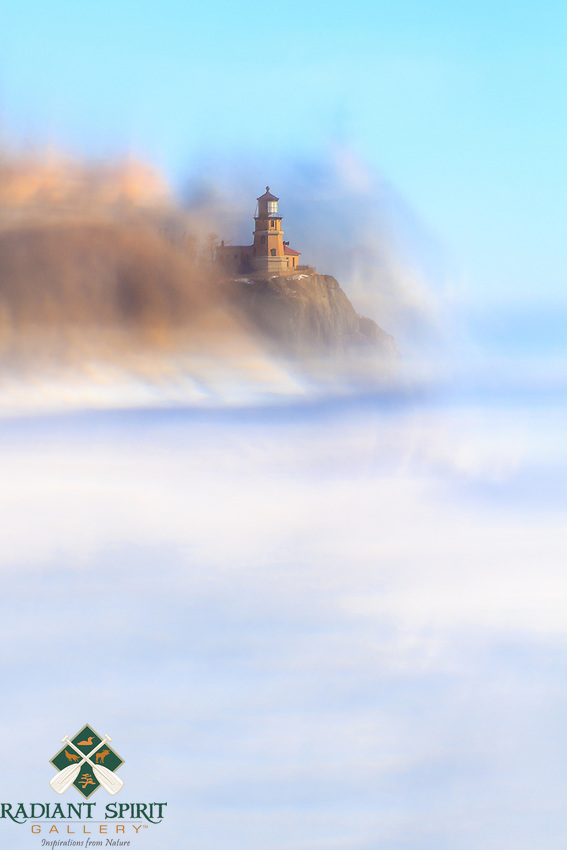 """""""Through a Frozen Lens""""<br /> Lake Superior's ice creates an artistic perspective of Split Rock Lighthouse. The ice plates are quite clear with various distortions. Focusing through the ice creates surprising images with the camera. No two images are alike."""