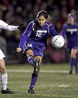 "University of Washington midfielder Jane Mitchell (12) clears the ball. In overtime, Boston College defeated University of Washington, 1-0, in NCAA tournament ""Elite 8"" match at Newton Soccer Field, Newton, MA, on November 27, 2010."
