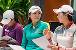 Hur Mi-jung (c) of Korea talks to Kim Hyo-joo (r) of Korea at the press conference ahead of the Hyundai China Ladies Open 2014 on December 10 2014 at Mission Hills Shenzhen, in Shenzhen, China. Photo by Li Man Yuen / Power Sport Images