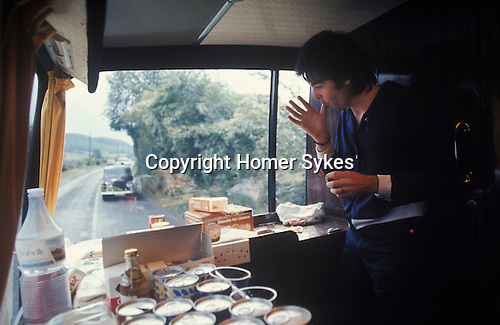 """Paul McCartney. 1970s Wings tour bus, his two Rolls Royce cars following. The photographs from this set were taken in 1975. I was on tour with them for a children's """"Fact Book"""". This book was called, The Facts about a Pop Group Featuring Wings. Introduced by Paul McCartney, published by G.Whizzard. They had recently recorded albums, Wildlife, Red Rose Speedway, Band on the Run and Venus and Mars. I believe it was the English leg of Wings Over the World tour. But as I recall they were promoting,  Band on the Run and Venus and Mars in particular."""