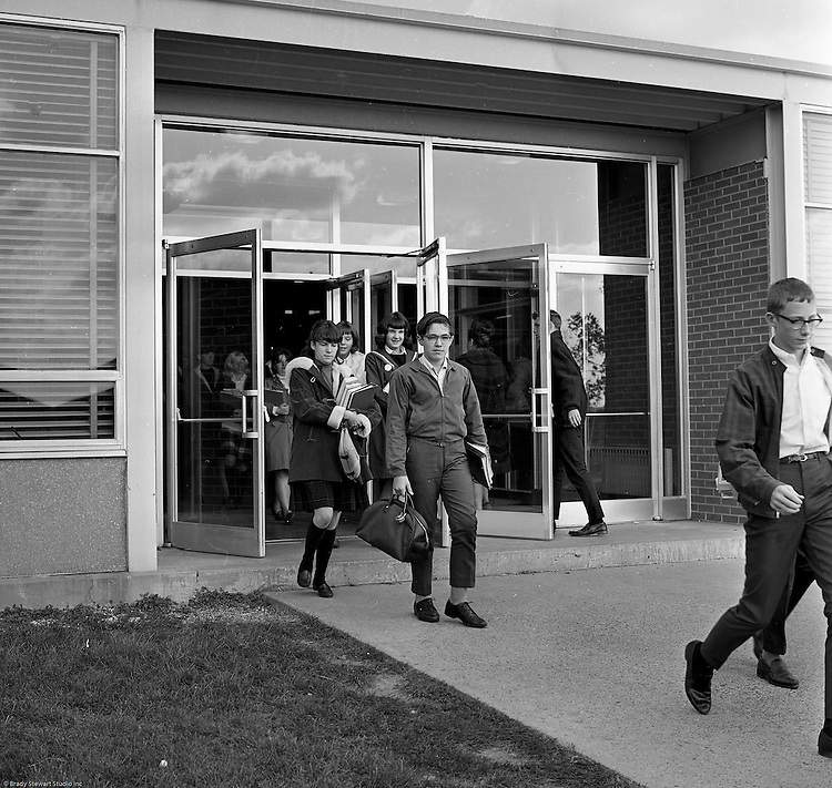 Bethel Park Senior High School:  View of students coming out of Building #2 between classes.  The new Bethel Senior High School was dedicated on October 23, 1960, but the campus would not grow to its current size until seven years later. Phase II of the construction was completed in 1964 with the addition of another academic building and the industrial arts building. Phase III was completed in 1967 with the construction of the fourth academic building and a 6,300 seat football stadium and track, three tennis courts, seven basketball courts, and a baseball field.