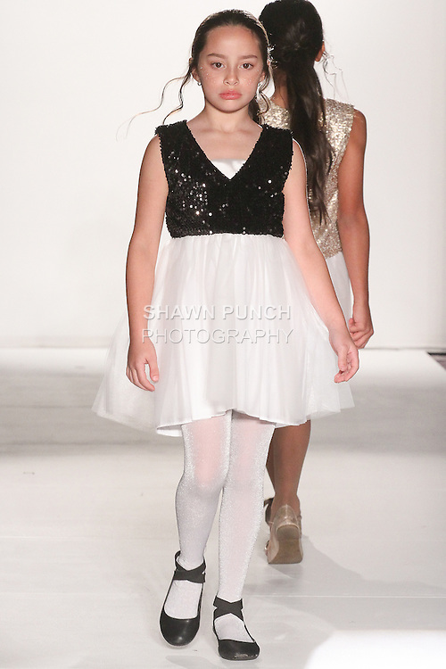 """Model walks runway in an outfit from Michelle Ann Fall Winter 2015 """"Glimmerati"""" collection by Michelle Ann, during the Designer's Collective Fall Winter 2015 fashion show for  Fashion Gallery New York Fashion Week Fall 2015."""