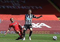 24th April 2021; Anfield, Liverpool, Merseyside, England; English Premier League Football, Liverpool versus Newcastle United; Thiago Alcantara of Liverpool fouls Miguel Almiron of Newcastle United