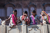 Jodhpur, India. Mehrangarh sandstone hill fort of the Marwar rulers. Four women in traditional clothes, watching.