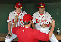 Ryan Westmoreland (24) of the Greenville Drive, left, talks with Sean Kileen, right, and Pete Ruiz in the dungout at a game on Sept. 5, 2010, at Fluor Field at the West End in Greenville, S.C. Westmoreland, once a Top 10 prospect in the Red Sox organiztion, had surgery in March to remove a cavernous malformation on his brain stem, and faces a difficult recovery. He is not yet playing, but is working out with the Drive as part of his rehabilitation. Photo by: Tom Priddy/Four Seam Images