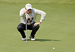 JEJU, SOUTH KOREA - APRIL 23:  Thomas Bjorn of Denmark lines up a putt on the 10th green during the fog-delayed Round One of the Ballantine's Championship at Pinx Golf Club on April 23, 2010 in Jeju island, South Korea.  Photo by Victor Fraile / The Power of Sport Images