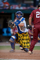 Savannah Bananas catcher Bill Leroy (1) checks the runner during a Coastal Plain League game against the Macon Bacon on July 15, 2020 at Grayson Stadium in Savannah, Georgia.  Savannah wore kilts for their St. Patrick's Day in July promotion.  (Mike Janes/Four Seam Images)