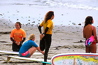 Saturday, June 14, 2008, Tourmaline Surf Park, Pacific Beach, San Diego, CA, USA.  Competitors prepare to enter the water for the womens final of the Pacific Beach Surf Club's Tenth Annual Longboard Classic at Tourmaline Surfing Park.  From left; Jacky Vinson, Michelle Connelly, Deb Hoyt and Mele Salli.  The event was well attended despite gray, June gloom clouds and fickle, windy surf conditions.