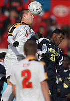 Casey Townsend #11 of the University of Maryland  heads the ball past Latif Alashe #21of the University of Michigan during an NCAA quarter-final match at Ludwig Field, University of Maryland, College Park, Maryland on December 4 2010.Michigan won 3-2 AET.