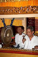 Myanmar, Burma.  Mandalay.  Mahamuni Buddhist Temple.  Musicians Playing Xylophone and Gong.