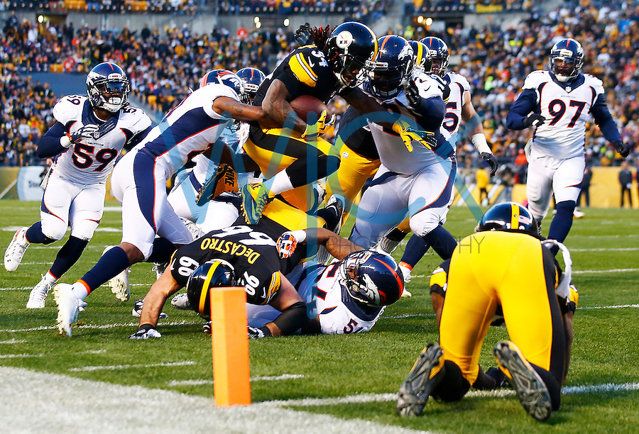 DeAngelo Williams #34 of the Pittsburgh Steelers hurdles over defenders while running with the ball in the first quarter against the Denver Broncos during the game at Heinz Field on December 20, 2015 in Pittsburgh, Pennsylvania. (Photo by Jared Wickerham/DKPittsburghSports)