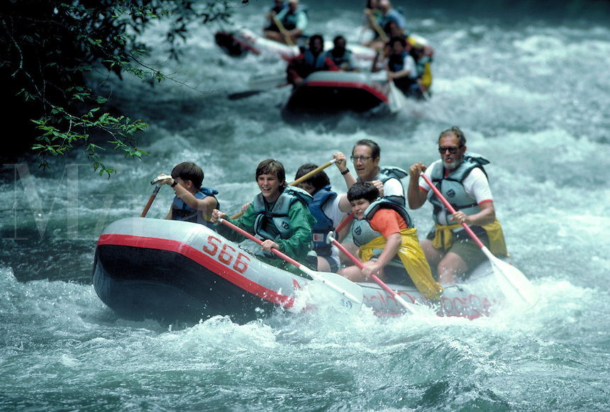 On a fast, whitewater river in the national forest in North Carolina Nanthlhala area, Boy Scouts and leaders enjoy an afternoon of whitewater rafting. fun, water, sports, child, children, youth groups. Boy Scouts whitewater rafting. North Carolina, Nataha