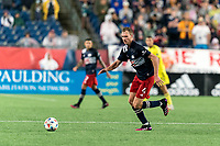 FOXBOROUGH, MA - AUGUST 4: Henry Kessler #4 of New England Revolution dribbles during a game between Nashville SC and New England Revolution at Gillette Stadium on August 4, 2021 in Foxborough, Massachusetts.