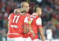 BOGOTÁ -COLOMBIA, 06-09-2014. Jugadores de Independiente Santa Fe celebran un gol anotado a Deportes Tolima durante partido por la fecha 8 de la Liga Postobón  II 2014 jugado en el estadio Nemesio Camacho el Campín de la ciudad de Bogotá./ Players of Independiente Santa Fe celebrate a goal scored to DeportesTolima during match for the 8th date of the Postobon League II 2014 played at Nemesio Camacho El Campin stadium in Bogotá city. Photo: VizzorImage/ Gabriel Aponte / Staff