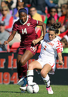 COLLEGE PARK, MD - OCTOBER 21, 2012:  Domenica Hodak (2) of the University of Maryland tackles Tiffany McCarty (14) of Florida State during an ACC women's match at Ludwig Field in College Park, MD. on October 21. Florida won 1-0.