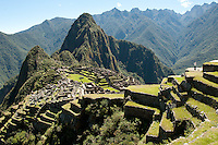 The Incas began building Machu Picchu in AD 1400, but abandoned it  a century later at the time of the Spanish Conquest.  It is thought that  its inhabitants may have died from smallpox introduced by travelers before the Spanish conquistadors arrived in the area. Most archaeologists think that Machu Picchu was built as an estate for the Inca emperor Pachacuti (1438-1472)