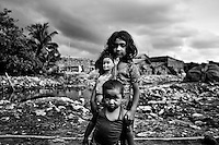 Children's are posing for a portrait at the highly polluted Hazaribagh tannery area on the banks of the River Buriganga in Dhaka, Bangladesh.