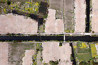 Demolition land contrasts the traditional agricultural land to make way for new housing developments. /Felix Features