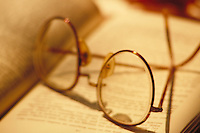 Glasses lying on book..