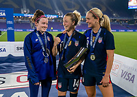 ORLANDO, FL - FEBRUARY 24: Rose Lavelle #16, Emily Sonnett #14 and Lindsey Horan #9 of the USWNT pose with the SheBelieves Cup during a game between Argentina and USWNT at Exploria Stadium on February 24, 2021 in Orlando, Florida.