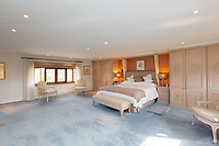 BNPS.co.uk (01202 558833)<br /> Pic: Savills/BNPS<br /> <br /> Pictured: One of the five spacious upstairs bedrooms.<br /> <br /> A historic thatched home where Cromwell's army stayed during the English Civil War is on the market for £1.6m.<br /> <br /> The Barracks, so-named for its links with Cromwell more than 370 years ago, has spectacular country views and is in one of Cheshire's most popular areas.<br /> <br /> The five-bedroom property just outside the picturesque village of Bunbury is a far cry from how it would have looked in Cromwell's time, having been extended over the years.<br /> <br /> It was used in the 17th century by Cromwell's armies during the siege of Beeston Castle - two miles away. The castle's location made it valuable to both the royalists and parliamentarians.