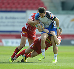 Connacht's Tiernan O'Halloran is tackled by Scarlet's Ken Owens and Olly Barkley<br /> <br /> Rugby - Scarlets V Connacht  - Rabodirect Pro12 - Sunday  30th March  2014 - Parc-y-Scarlets - Llanelli<br /> <br /> © www.sportingwales.com- PLEASE CREDIT IAN COOK