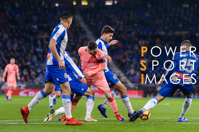 Lionel Messi of FC Barcelona (C) fights for the ball with Didac Vila of RCD Espanyol (R) during the La Liga 2018-19 match between RDC Espanyol and FC Barcelona at Camp Nou on 08 December 2018 in Barcelona, Spain. Photo by Vicens Gimenez / Power Sport Images