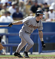 Gregg Zaun of the Houston Astros bats during a 2002 MLB season game against the Los Angeles Dodgers at Dodger Stadium, in Los Angeles, California. (Larry Goren/Four Seam Images)