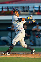 Enmanuel Paulino (3) of the Princeton Rays follows through on his swing against the Burlington Royals at Burlington Athletic Park on July 11, 2014 in Burlington, North Carolina.  The Rays defeated the Royals 5-3.  (Brian Westerholt/Four Seam Images)