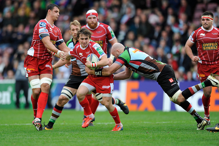 Rhodri Williams of Scarlets is tackled by George Robson of Harlequins during the Heineken Cup Round 1 match between Harlequins and Scarlets at the Twickenham Stoop on Saturday 12th October 2013 (Photo by Rob Munro)