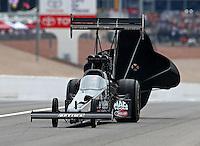 Mar 29, 2014; Las Vegas, NV, USA; NHRA top fuel driver J.R. Todd during qualifying for the Summitracing.com Nationals at The Strip at Las Vegas Motor Speedway. Mandatory Credit: Mark J. Rebilas-