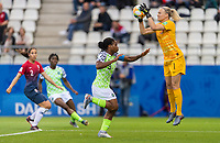 REIMS, FRANCE - JUNE 8: Desire Oparanozie #9 of Nigeria sprints toward Ingrid Hjelmseth #1  of Norway as she saves the ball during a 2019 FIFA Women's World Cup match between Norway and Nigeria at Stade Auguste-Delaune on June 8, 2019 in Reims, France.